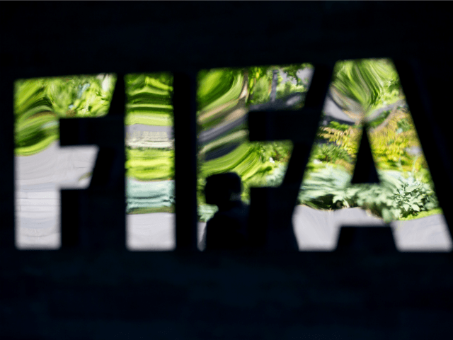 ZURICH, SWITZERLAND - JUNE 03: A FIFA logo sits next to the entrance at the FIFA headquarters on June 3, 2015 in Zurich, Switzerland. Joseph S. Blatter resigned as president of FIFA. The 79-year-old Swiss official, FIFA president for 17 years said a special congress would be called to elect …