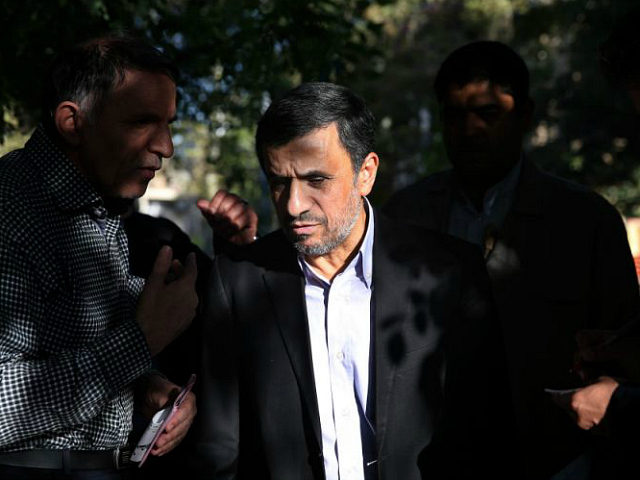 Former Iranian President Mahmoud Ahmadinejad, center, talks with a man after receiving his petition for help outside his house in northeastern Tehran, Iran, Monday, Aug. 3, 2015. Ahmadinejad receive petitions there to pass on to authorities. He has launched a political campaign ahead of February's parliamentary elections in what could …