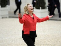 "US secreatry of State Hillary Clinton gestures as she arrives at the Elysee palace for a meeting with french President Nicolas Sarkozy prior to a conference on Libya's post-Moamer Kadhafi future on September 1, 2011 in Paris. France hosts a ""Friends of Libya"" conference to allow states that stood by …"