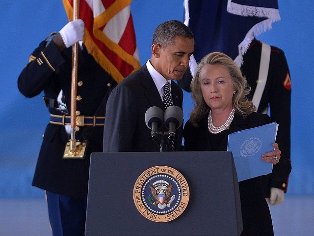 US President Barack Obama and Secretary of State Hillary Clinton attend the transfer of remains ceremony marking the return to the US of the remains of the four Americans killed in an attack this week in Benghazi, Libya, at the Andrews Air Force Base in Maryland on September 14, 2012. …