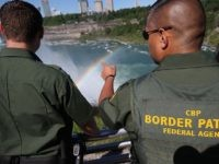 NIAGARA FALLS, NY - JUNE 04: A rainbow forms in the mist of Niagara Falls as U.S. Border Patrol agents patrol the area on June 4, 2013 in Niagara Falls, New York. The major tourist attraction, which falls directly on the U.S.-Canada border, is a major destination for international visitors. …