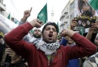 "Supporters of the Muslim Brotherhood in Jordan shout slogans during a demonstration in the capital Amman on November 28, 2014, against Israeli ""violations"" regarding the Al-Aqsa mosque compound in east Jerusalem. The tensions soared earlier this month when Israeli police entered the Al-Aqsa mosque compound during clashes triggered by a vow by far-right Jewish groups to pray at the holy site. AFP PHOTO / KHALIL MAZRAAWI        (Photo credit should read KHALIL MAZRAAWI/AFP/Getty Images)"