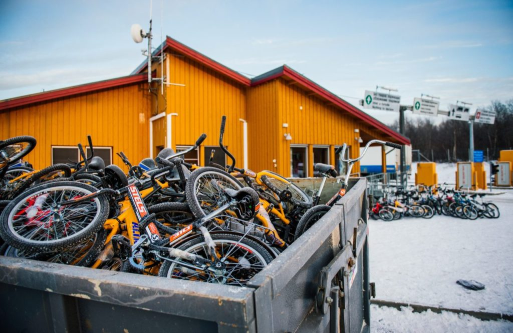 Bikes used by refugees to cross the border from Russia to the Norwegian border crossing station at Storskog are pictured after they were thrown into a recycling container on November 12, 2015 near Kirkenes in northern Norway. An increasingly popular route for migrants across Russia and into Norway has Oslo angered and worried as winter approaches, while commentators suspect Moscow is deliberately creating problems for its neighbour. Initially, the news that migrants were making a long detour through the Arctic had a whimsical quality to it: migrants have to make the last section of their journey by bicycle because Russian authorities don't let pedestrians cross the border and Norway considers it human trafficking to transport migrants in a vehicle. AFP PHOTO / JONATHAN NACKSTRAND (Photo credit should read JONATHAN NACKSTRAND/AFP/Getty Images)