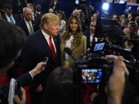 LAS VEGAS, NV - DECEMBER 15:  Republican presidential candidate Donald Trump and his wife Melania Trump talk to reporters in the spin room following the CNN presidential debate at The Venetian Las Vegas on December 15, 2015 in Las Vegas, Nevada. Thirteen Republican presidential candidates are participating in the fifth set of Republican presidential debates.  (Photo by Ethan Miller/Getty Images)