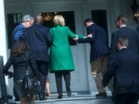 Democratic Presidential candidate, former Secretary of State Hillary Clinton slips as she walks up the stairs into the non-profit SC Strong, a 2 year residential facility that helps former felons, substance abusers, and homeless move into self-sufficiency February 24, 2016 in North Charleston.