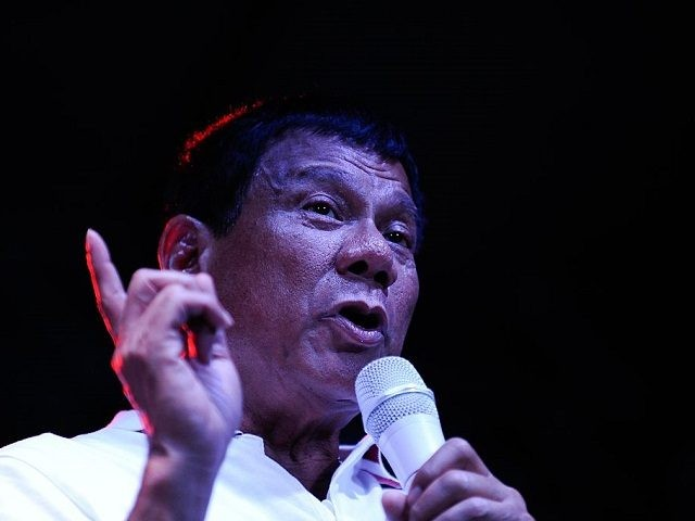 MANILA, PHILIPPINES - MAY 01: Philippine presidential candidate Rodrigo Duterte gestures during a labor day campaign rally on May 1, 2016 in Manila, Philippines. Duterte, a tough-talking mayor of Davao in Mindanao has been the surprise pre-election poll favourite pulling away from his rivals despite controversial speeches and little national …