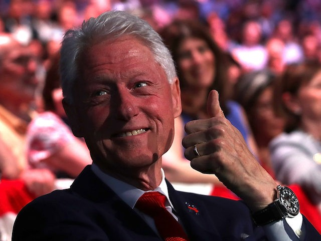 BROOKLYN, NY - JUNE 07: Former U.S. president Bill Clinton (R) gives the thumbs-up to his daughter Chelsea Clinton as his wife, Democratic presidential candidate former Secretary of State Hillary Clinton, speaks during a primary night event on June 7, 2016 in Brooklyn, New York. Hillary Clinton surpassed the number …