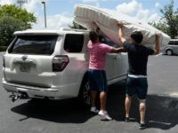 Venezuelan immigrants collect donations from Venezuela Awareness, a foundation created to help Venezuelan immigrants, at a storage facility in Miami, Florida, on June 03, 2016. Since early 2014, Venezuela has been among the top 10 asylum-seeking nations in the US. 'The foreign-born population of Venezuelan origin living in the US …