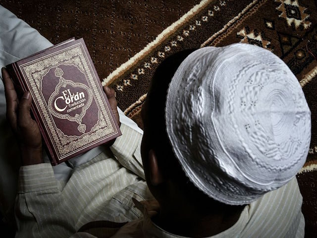 A Muslim Cuban man reads the Koran at the Abdallah mosque during Ramadan in Havana, on July 1, 2016. The small Muslim community of Cuba celebrates discreetly the end of its Ramadan. / AFP / ADALBERTO ROQUE / TO GO WITH AFP STORY BY ROMANE FRACHON (Photo credit should read …