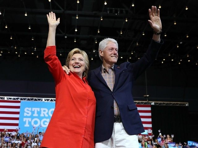 Democratic presidential nominee former Secretary of State Hillary Clinton and her husband former U.S. president Bill Clinton greet supporters during a campaign rally with democratic vice presidential nominee U.S. Sen Tim Kaine (D-VA) at the David L. Lawrence Convention Center on July 30, 2016 in Pittsburgh, Pennsylvania. Hillary Clinton and …