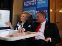 : Democratic presidential nominee former Secretary of State Hillary Clinton (L) and democratic vice presidential nominee U.S. Sen Tim Kaine (D-VA) (R) sit on their campaign bus after attending church services Amani Temple Ministries on July 31, 2016 in Cleveland, Ohio. Hillary Clinton and Tim Kaine are wrapping up their three-day bus tour through Pennsylvania and Ohio. (Photo by