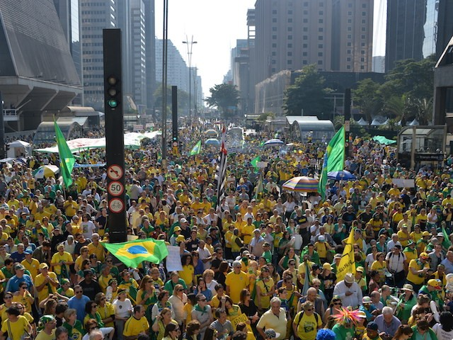 Hundreds of people hold a protest against suspended president Dilma Rousseff in Sao Paulo, on July 31, 2016. Protesters took to the streets of Brazil on Sunday to demand the final leaving of suspended President Dilma Rousseff or to defend her continuance, just five days before the start of the Rio 2016 Olympic Games. / AFP / NELSON ALMEIDA (Photo credit should read NELSON ALMEIDA/AFP/Getty Images)