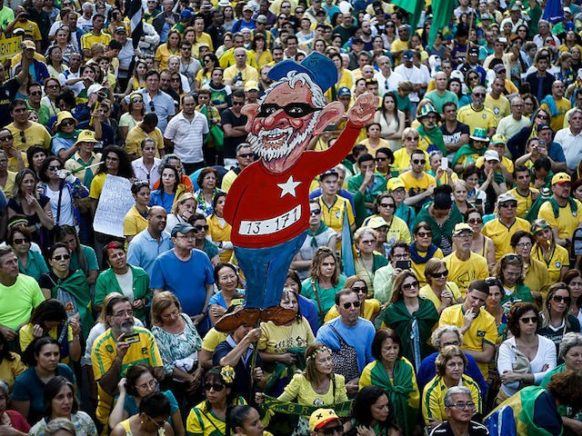 Activists protest against suspended president Dilma Rousseff in Sao Paulo, Brazil on July 31, 2016. Protesters took to the streets of Brazil on Sunday to demand the final leaving of suspended President Dilma Rousseff or to defend her permanence, just five days before the start of the Rio 2016 Olympic …