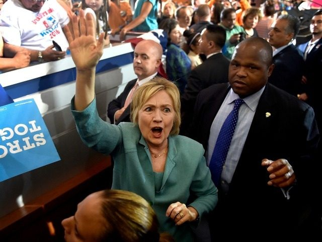 Democratic presidential nominee former Secretary of State Hillary Clinton waves to supporters after speaking at the International Brotherhood of Electrical Workers Union Hall on August 4, 2016 in Las Vegas, Nevada. According to recent polls, Clinton leads her opponent Republican Donald Trump in several swing states including New Hampshire and …