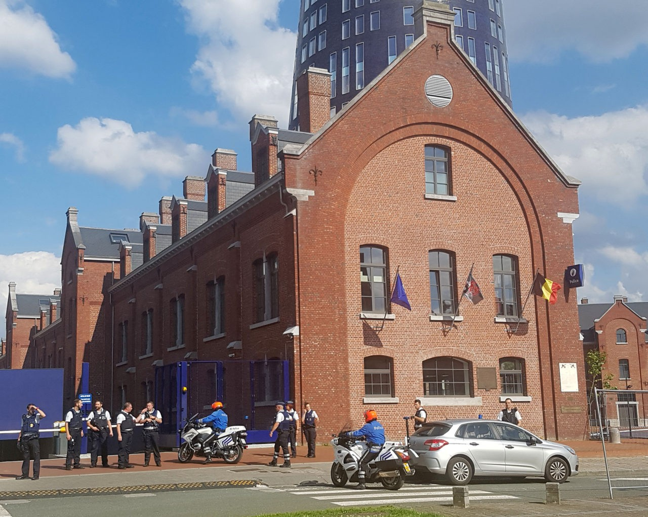 """A photo taken with a mobile phone on August 6, 2016, shows police securing the area around a police building in the southern Belgian city of Charleroi following a machete attack. Two policewomen were wounded in Charleroi by a machete-wielding man who shouted """"Allahu akbar"""" (God is the greatest), local police said. The attacker was shot and injured, they said on Twitter. / AFP / BELGA AND Belga / FRED DUBOIS / Belgium OUT (Photo credit should read FRED DUBOIS/AFP/Getty Images)"""