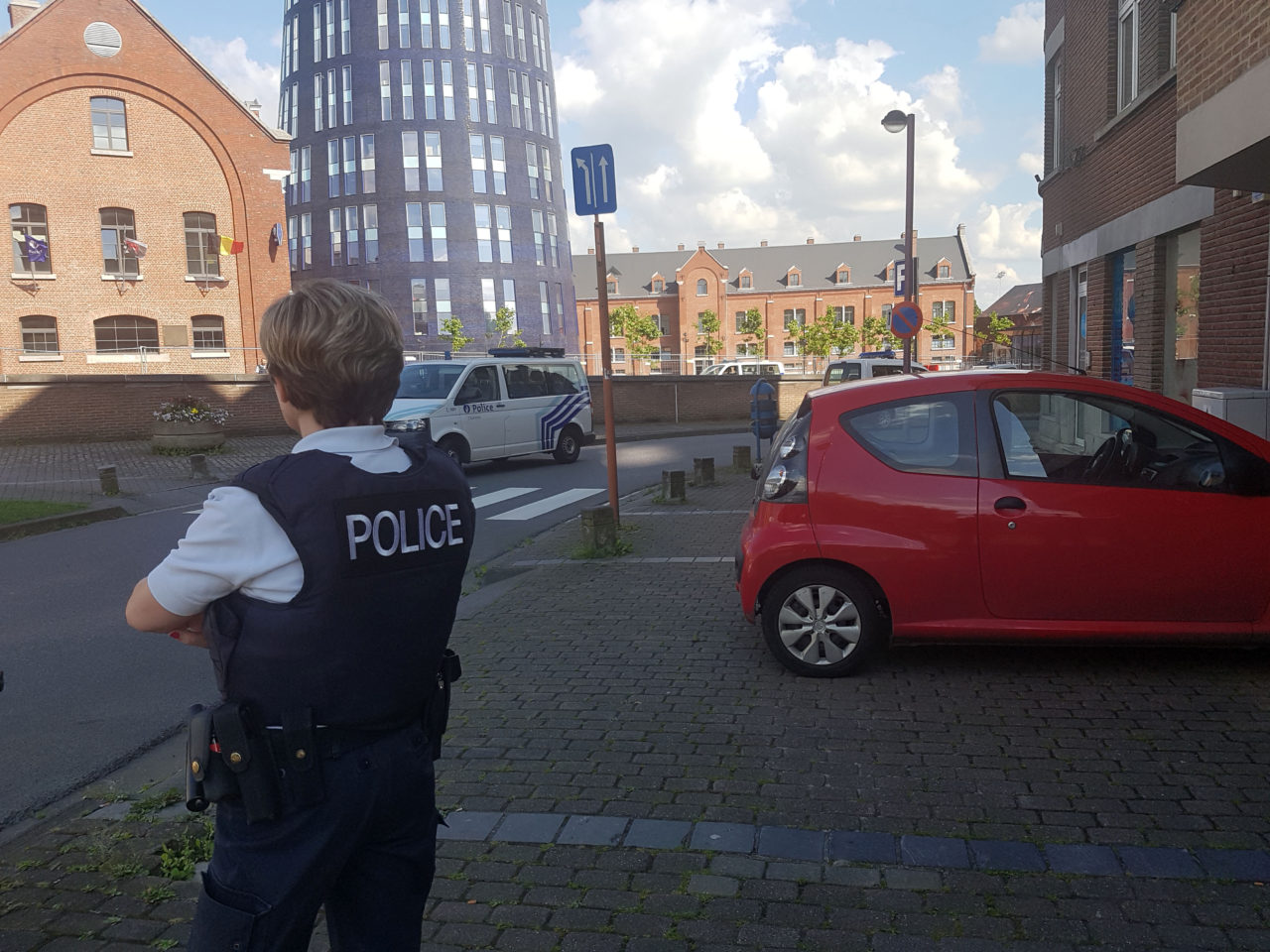 """A photo taken with a mobile phone on August 6, 2016, shows a police officer standing guard close to a police building in the southern Belgian city of Charleroi following a machete attack. Two policewomen were wounded in Charleroi by a machete-wielding man who shouted """"Allahu akbar"""" (God is the greatest), local police said. The attacker was shot and injured, they said on Twitter. / AFP / BELGA AND Belga / FRED DUBOIS / Belgium OUT (Photo credit should read FRED DUBOIS/AFP/Getty Images)"""