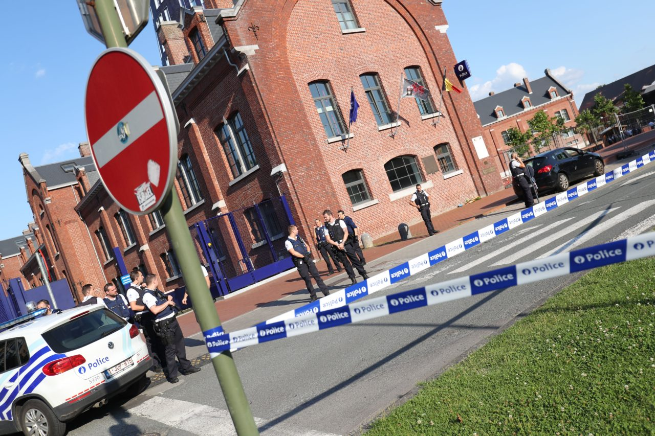 """Police stand as they secure the area around a police building in the southern Belgian city of Charleroi following a machete attack on August 6, 2016. Two policewomen were wounded in Charleroi by a machete-wielding man who shouted """"Allahu akbar"""" (God is the greatest), local police said. The attacker was shot and injured, they said on Twitter. / AFP / BELGA / VIRGINIE LEFOUR / Belgium OUT (Photo credit should read VIRGINIE LEFOUR/AFP/Getty Images)"""
