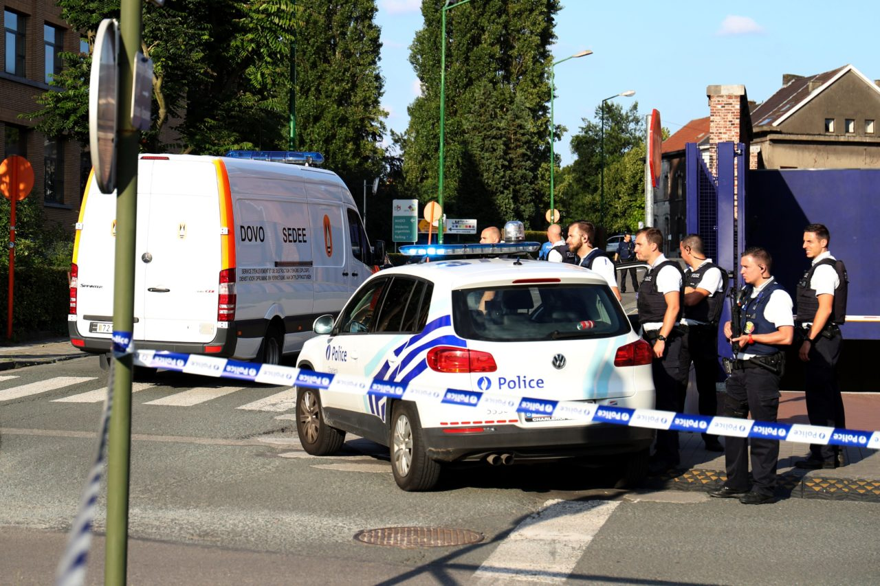 """Policemen stand guard as a Belgian Army Mine Clearance Department van arrives inside the security perimeter around the police building in the southern Belgian city of Charleroi following a machete attack on August 6, 2016. A machete-wielding man shouting """"Allahu akbar"""" (God is the greatest) wounded two policewomen in southern Belgium today before being shot dead by police, with Europe on edge after a wave of jihadist attacks. / AFP / BELGA / VIRGINIE LEFOUR / Belgium OUT (Photo credit should read VIRGINIE LEFOUR/AFP/Getty Images)"""