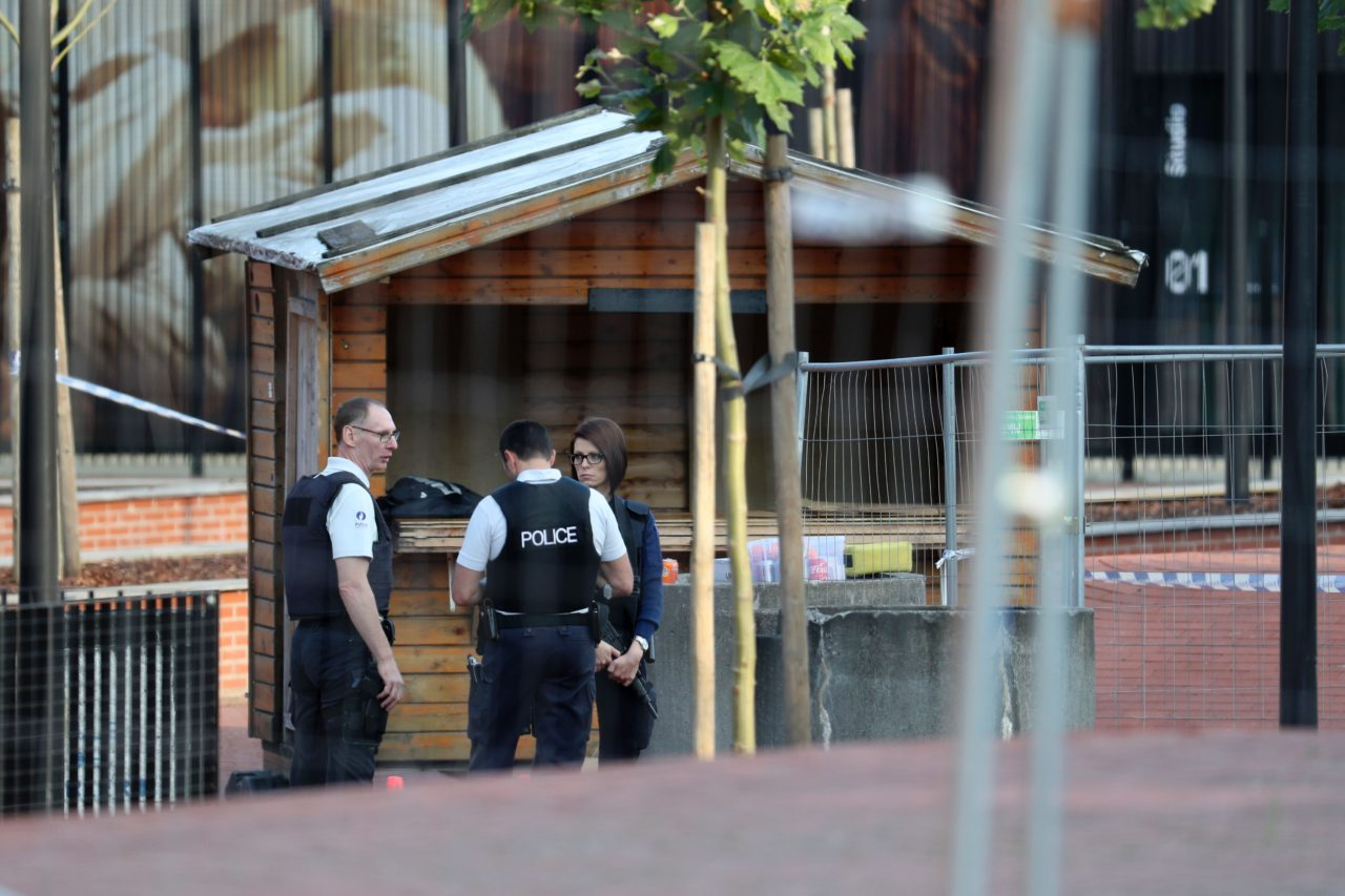Police stand as they secure the area around a police building in the southern Belgian city of Charleroi following a machete attack on August 6, 2016. A machete-wielding man who wounded two policewomen on August 6, in the southern Belgian city of Charleroi has died after being shot by officers. / AFP / BELGA / VIRGINIE LEFOUR / Belgium OUT (Photo credit should read VIRGINIE LEFOUR/AFP/Getty Images)