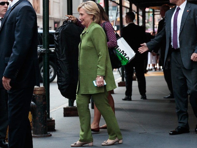 NEW YORK, NY - AUGUST 18: Democratic presidential candidate Hillary Clinton is escorted to her motorcade by U.S. Secret Service agents as she leaves a private meeting at the Sheraton Times Square Hotel, August 18, 2016 in New York City. Earlier in the day, Clinton met with law enforcement officials …