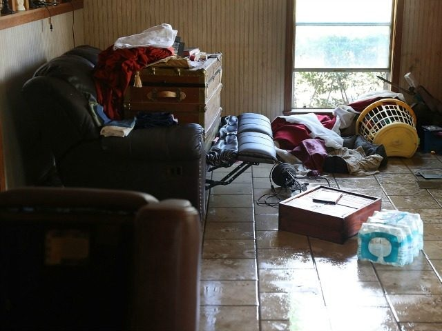 A living room is seen after flood waters inundated it on August 19, 2016 in St Amant, Louisiana. Last week Louisiana was overwhelmed with flood water causing at least thirteen deaths and thousands of homes damaged by the flood waters. (Photo by
