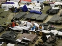 Evacuees take advantage of the shelter setup in the The Baton Rouge River Center arena as the area deals with the record flooding that took place causing thousands of people to seek temporary shelter on August 19, 2016 in Baton Rouge, Louisiana. Last week Louisiana was overwhelmed with flood water causing at least thirteen deaths and thousands of damaged homes. (Photo by