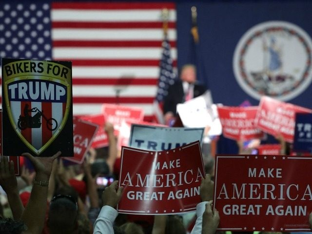 Supporters hold up signs during a campaign rally of Republican presidential nominee Donald Trump at Fredericksburg Expo Center August 20, 2016 in Fredericksburg, Virginia.