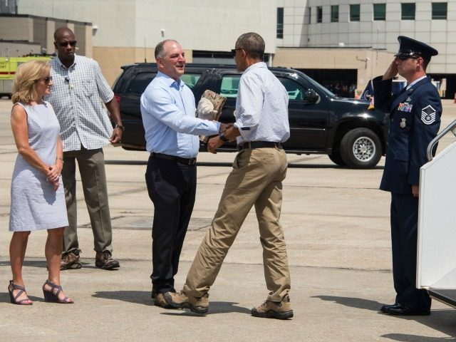 S President Barack Obama is greeted by Louisiana Governor John Bel Edwards and his wife Donna at Baton Rouge Metropolitan Airport in Baton Rouge, Louisiana, on August 23, 2016. Fresh from a two-week vacation, President Barack Obama visits flood-hit Louisiana, hoping to offer support to devastated communities and silence his …