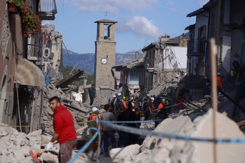 Rescuers and firemen inspect the rubble of buildings in Amatrice on August 24, 2016 after a powerful earthquake rocked central Italy. The earthquake left 38 people dead and the total is likely to rise, the country's civil protection unit said in the first official death toll. Scores of buildings were reduced to dusty piles of masonry in communities close to the epicentre of the pre-dawn quake in a remote area straddling the regions of Umbria, Marche and Lazio. / AFP / FILIPPO MONTEFORTE (Photo credit should read FILIPPO MONTEFORTE/AFP/Getty Images)
