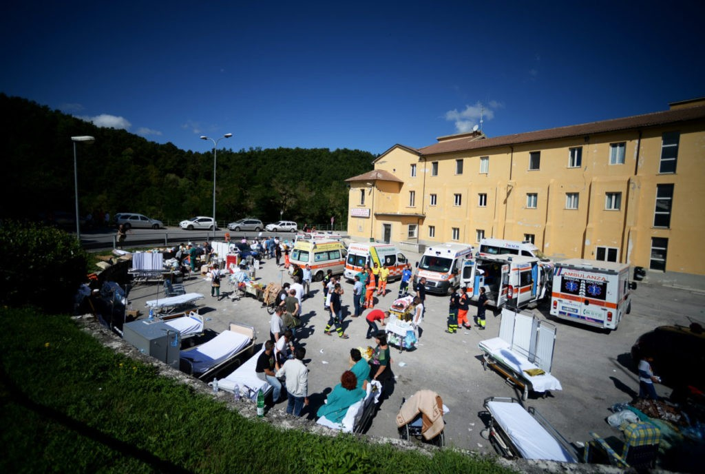 Rescuers set up a first aid camp in the courtyard of the hospital of Amatrice on August 24, 2016 after a powerful earthquake rocked central Italy. The earthquake left 38 people dead and the total is likely to rise, the country's civil protection unit said in the first official death toll. Scores of buildings were reduced to dusty piles of masonry in communities close to the epicentre of the pre-dawn quake in a remote area straddling the regions of Umbria, Marche and Lazio. / AFP / FILIPPO MONTEFORTE (Photo credit should read FILIPPO MONTEFORTE/AFP/Getty Images)