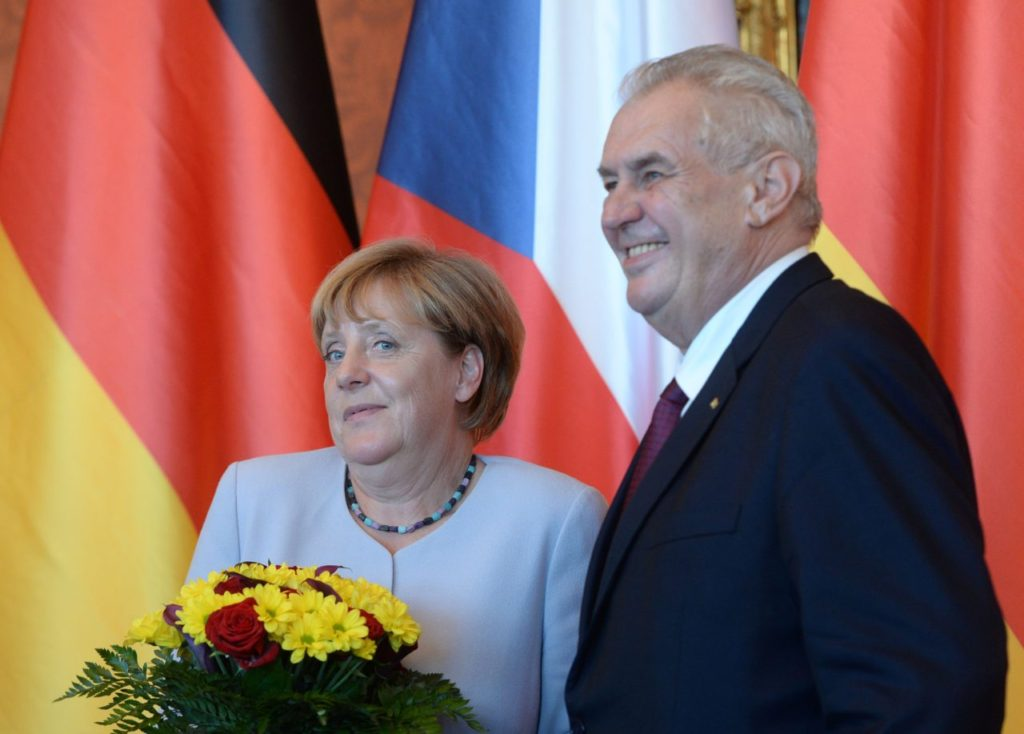 Czech President Milos Zeman (R) and German Chancellor Angela Merkel pose for a photo before their meeting on August 25, 2016 at the Prague Castle. / AFP / Michal Cizek (Photo credit should read MICHAL CIZEK/AFP/Getty Images)