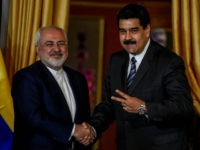 Venezuela's President Nicolas Maduro (R) and Iranian Foreign Minister Mohammad Javad Zarif meet in Caracas on August 27, 2016. The governments of Venezuela and Iran agreed to increase their economic cooperation during the visit of Iranian Foreign Minister Mohammad Javad Zarif to Caracas. / AFP / JUAN BARRETO        (Photo credit should read JUAN BARRETO/AFP/Getty Images)