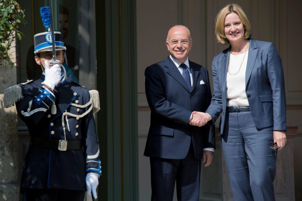 French Interior Minister Bernard Cazeneuve (L) shakes hands with British Home Secretary Amber Rudd before a meeting on August 30, 2016 in Paris. / AFP / BERTRAND GUAY (Photo credit should read BERTRAND GUAY/AFP/Getty Images)