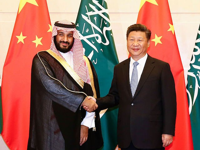 BEIJING, CHINA - AUGUST 31: Saudi Arabia Deputy Crown Prince Mohammed bin Salman (L) and Chinese President Xi Jinping (R) shake hands during a meeting at the Diaoyutai State guest house on August 31, 2016 in Beijing, China. The deputy prince is meeting Chinese officials during his visit to boost …