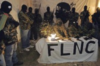 -, FRANCE: Picture taken in an undisclosed location in Southern Corsica at the end of October 2006 showing four spokesmen of the outlawed National Liberation Front of Corsica (FNLC) flanked by armed and hooded militants holding a press conference in a remote farm with two Corsican journalists (out of camera …