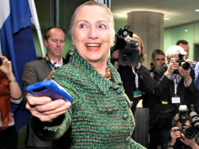 Hillary Hands over Blackberry AP