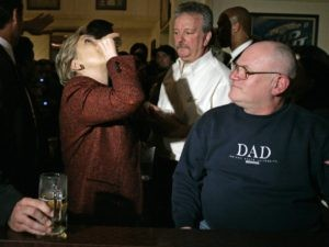 Democratic presidential hopeful ,Sen. Hillary Rodham Clinton, D-N.Y., tosses back a shot of Crown Royal with Bronko's owner Nick Tarailo, second from right, and Ed Hall, right as she stops at the bar during a campaign stop at Bronko's restaurant in Crown Point, Ind., on Saturday, April 12, 2008. (AP Photo/Carolyn Kaster)