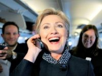 Democratic presidential hopeful, Sen. Hillary Rodham Clinton, D-N.Y., talk on the phone with a girlfriend of a member of the traveling press as she passed out Valentine's day chocolates aboard her campaign plane as it sat on the tarmac at the Youngstown Airport in Vienna, Ohio, Thursday, Feb. 14, 2008. (AP Photo/Carolyn Kaster)