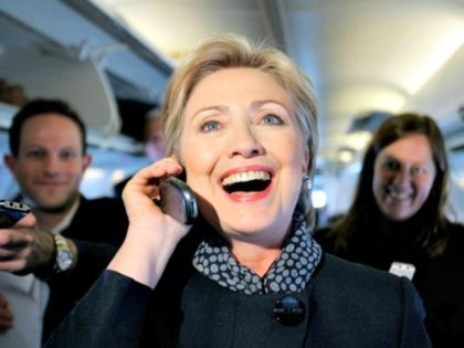 Democratic presidential hopeful, Sen. Hillary Rodham Clinton, D-N.Y., talk on the phone with a girlfriend of a member of the traveling press as she passed out Valentine's day chocolates aboard her campaign plane as it sat on the tarmac at the Youngstown Airport in Vienna, Ohio, Thursday, Feb. 14, 2008. …