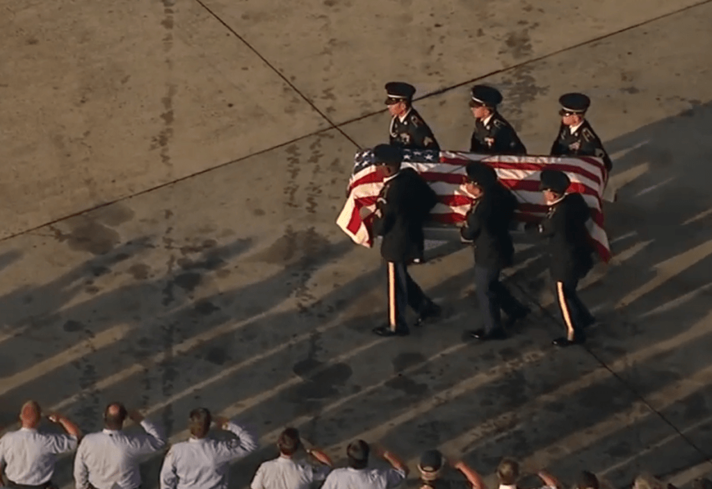 Army honor guard escorts the remains of Flight Officer Judon Baskett after arriving at George Bush Intercontinental Airport in Houston. (Photo: KTRK ABC13 Video Screenshot)