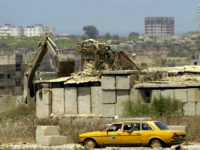 NETZARIM JUNCTION, GAZA STRIP - JULY 31: In this handout photo from the Israeli Military, a Palestinian taxi drives past July 31, 2003 as the army's outpost at the Netzarim junction in Gaza is dismantled. Israel and the Palestinians failed to reach an agreement on the transfer of further West …