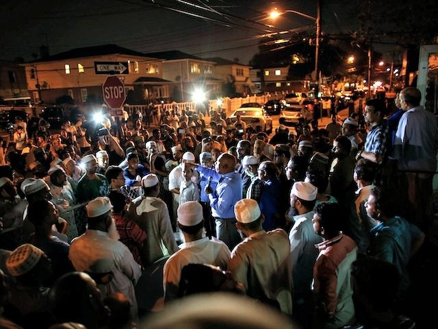 Community members pray outside the Al-Furqan Jame Mosque in Ozone Park after imam Maulama Akonjee and friend Thara Uddin were killed in the Queens borough of New York City, August 13, 2016. An imam and his assistant were both shot in the head and killed in New York Saturday, police …