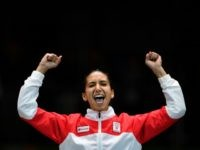Tunisia's bronze medallist Ines Boubakri celebrates on the podium during the medal ceremony for the women's individual foil fencing event of the Rio 2016 Olympic Games at the Carioca Arena 3 in Rio de Janeiro on August 10, 2016. / AFP / Fabrice COFFRINI (Photo credit should read FABRICE COFFRINI/AFP/Getty Images)