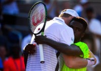 NEW YORK, NY - AUGUST 29: John Isner and Frances Tiafoe of the United States embrace after their first round Men's Singles match on Day One of the 2016 US Open at the USTA Billie Jean King National Tennis Center on August 29, 2016 in the Flushing neighborhood of the …