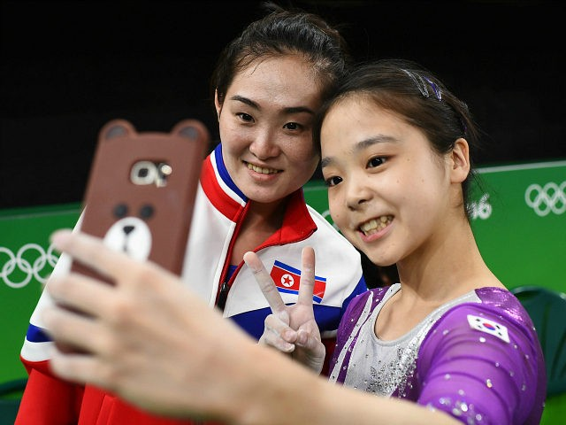 Lee Goim of South Korea (R) takes a selfie picture with Hong Un Jong of North Korea. REUTERS/Dylan Martinez by Canice Leung August 4 at 10:27 AM