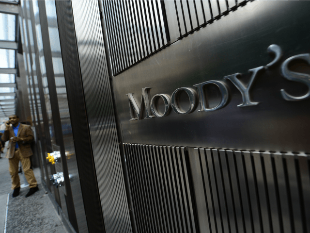 A sign for Moody's rating agency is displayed at the company headquarters in New York, September 18, 2012. AFP PHOTO/Emmanuel Dunand (Photo credit should read EMMANUEL DUNAND/AFP/GettyImages)