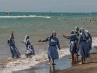 Nuns on beach