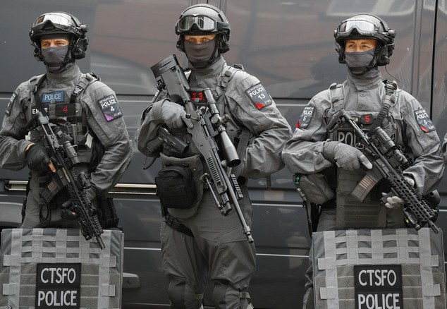 Police counter terrorism officers pose during a media opportunity in London, Wednesday, Aug. 3, 2016. London's police force is putting more armed officers on the streets 'to protect against the threat of terrorism.'' The increase in the number of officers follows attacks in France, Belgium and Germany. (AP Photo/Kirsty Wigglesworth)