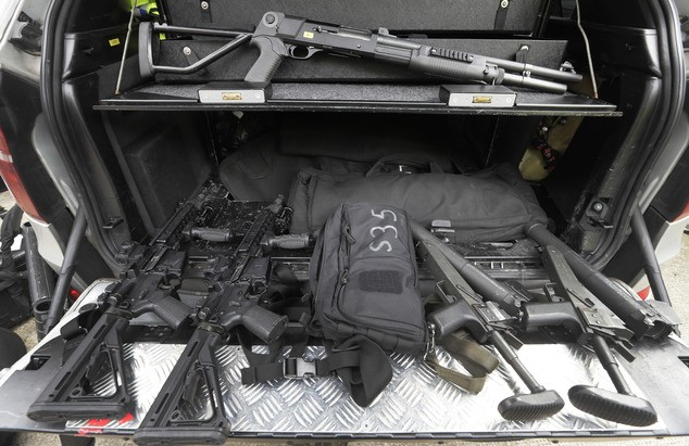 Police weapons are displayed in a police car during a media opportunity in London.  (AP Photo/Kirsty Wigglesworth)