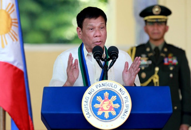 FILE - In this Friday, July 1, 2016, file photo, Philippine President Rodrigo Duterte addresses the troops during a military ceremony in suburban Quezon city northeast of Manila, Philippines. President Duterte in a speech late Thursday acknowledged abuses in a battle against illegal drugs, which has left more than 400 suspects dead and alarmed rights activists, but is not backing down from a shoot-to-kill order for drug suspects. (AP Photo/Bullit Marquez, File)